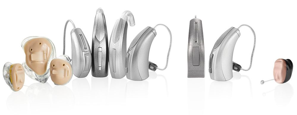 Hearing aids lined up representing the variety of brands carried by Hearing Associates servicing Denver, CO
